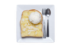 Ice cream and almond slice on toast Royalty Free Stock Photography