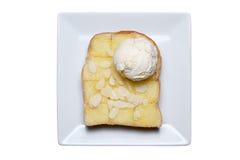 Ice cream and almond slice on toast Stock Photos
