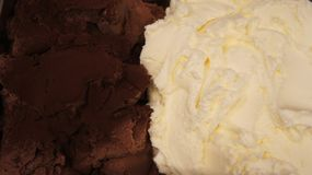 Ice cream as background. Close up of a chocolate and Cream whipped or sour cream on white background Stock Image