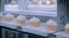 Ice cream automatic production line at modern food dairy fabric. Icecream automatic production line - conveyor belt with ice cream cones at modern food stock video footage