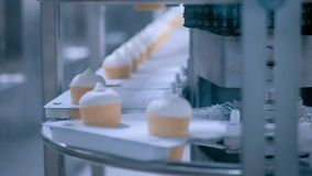 Ice cream automatic production line at modern food dairy fabric. Icecream automatic production line - conveyor belt with ice cream cones at modern food stock video