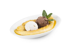 Ice cream with banana. Two scoops of ice cream, cream and chocolate with a banana fried in sugar syrup Royalty Free Stock Photography