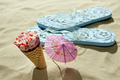 Ice cream on beach and sandals Royalty Free Stock Photos