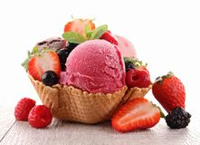 Ice cream and berry fruit royalty free stock photography