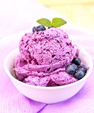 Ice cream blueberry with mint in bowl on napkin Royalty Free Stock Photos