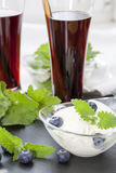 Ice cream with Bog blueberry and lemon balm, Glasses with fresh Black Currant juice Stock Photos