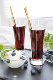 Ice cream with Bog blueberry and lemon balm, Glasses with fresh Black Currant juice Royalty Free Stock Images