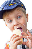 Ice cream boy 2. Close-up of young boy eating ice cream cone on a white background Royalty Free Stock Image