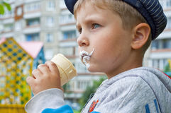 Ice cream boy. Close-up of young boy eating ice cream cone Royalty Free Stock Photos
