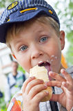 Ice cream boy. Close-up of young boy eating ice cream cone Stock Images