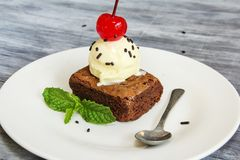 Ice cream and browny with cherry and mint Royalty Free Stock Image