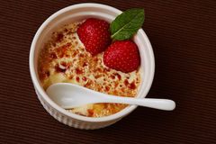 Ice cream brulee with spoon Royalty Free Stock Photos