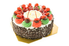 Ice cream cake with christmas theme and cheery on top Stock Photography