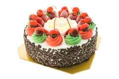 Ice cream cake with christmas theme and cheery on top Stock Photos