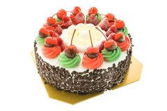 Ice cream cake with christmas theme and cheery on top Stock Images