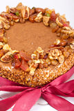 Ice cream cake. Delisious boutique Ice Cream Cake with nuts and res ribbon Stock Images
