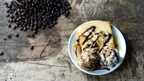 Ice cream and cake. Put on a wood table with dark roasted coffee beans Royalty Free Stock Image