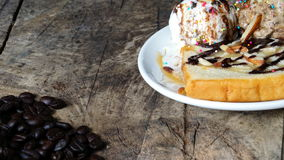 Ice cream and cake. Put on a wood table with dark roasted coffee beans Royalty Free Stock Photography