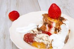 Ice cream cake. Strawberries,cream , chocolate and jams Royalty Free Stock Photography