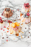 Ice cream cakes with toppings Stock Photography