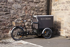 Ice Cream Cart With Bicycle. An ice cream cart is built on a bicycle in Edinburgh Royalty Free Stock Photos