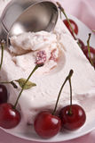 Ice cream and cherries Stock Images