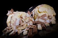 Ice cream on chocolate Stock Photography