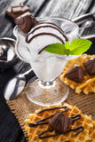 Ice Cream with chocolate candies, Mint and waffles. Royalty Free Stock Image