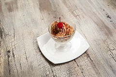 Ice cream with chocolate crumb and cherry in bowl Royalty Free Stock Photo