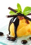 Ice cream with chocolate sauce and mint sticks Stock Image