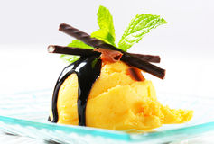 Ice cream with chocolate sauce and mint sticks Royalty Free Stock Photo