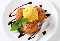Ice cream with chocolate syrup royalty free stock image
