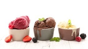 Ice cream. Chocolate, vanilla and strawberry royalty free stock images