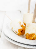 Ice cream with cloudberries, northern berries Stock Photography