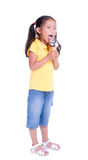 Ice Cream cone. A young girl with a summertime treat. Ice cream cone Royalty Free Stock Photos