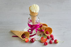 Ice cream in the cone with berries. Ice cream in the cone with fresh berries, copy space Stock Image