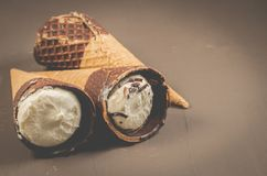 ice cream with cone in chocolate/ice cream with cone in chocolate on a dark background, selective focus and copy space stock photography