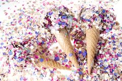 Ice cream cone with confetti Royalty Free Stock Photos