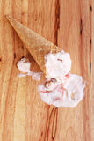 Ice cream cone drop on wooden background Royalty Free Stock Images