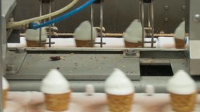 Filling of wafer cups with ice cream. Ice cream in a cone. Filling of wafer cups with ice cream. Ice cream production line. Vanilla ice cream stock video