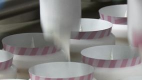 Ice cream production line. Ice cream in a cone. Ice cream fills paper cups. Ice cream factory. Ice cream production line stock footage