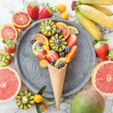 Ice cream cone with fresh fruits Royalty Free Stock Image