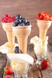 Ice cream cone and fruits Stock Image