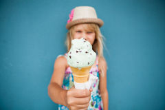 Ice cream cone held by young girl Royalty Free Stock Image