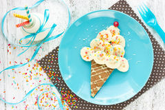 Ice cream cone pancake with banana and milk for creative kid bre Royalty Free Stock Image
