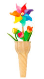 Ice cream cone with pinwheel and flowers Royalty Free Stock Photo