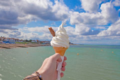 Ice cream cone by the seaside Royalty Free Stock Photos