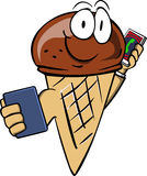 Ice cream cone speaking on a smartphone while reading a tablet Royalty Free Stock Photography