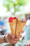 Ice cream cone with topping Royalty Free Stock Images
