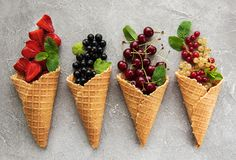 Ice cream cones with berries royalty free stock image